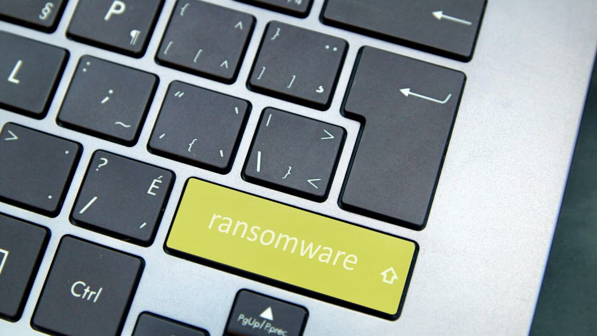 "A laptop keyboard with a yellow ""ransomware key"" Multiple companies in the Canadian supply chain have been targeted by ransomware attacks including Manitoulin Transport."