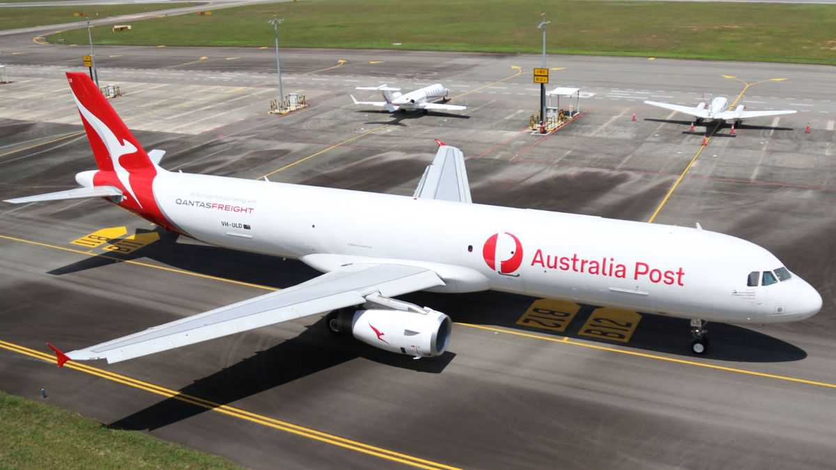 A white jet with red tail, Australia Post livery.