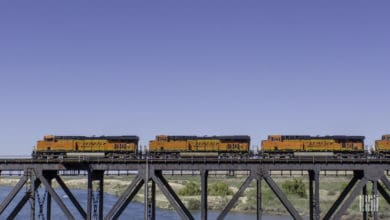 A photograph of three BNSF locomotives crossing a bridge.