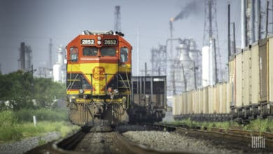 A Kansas City Southern train travels past a city.