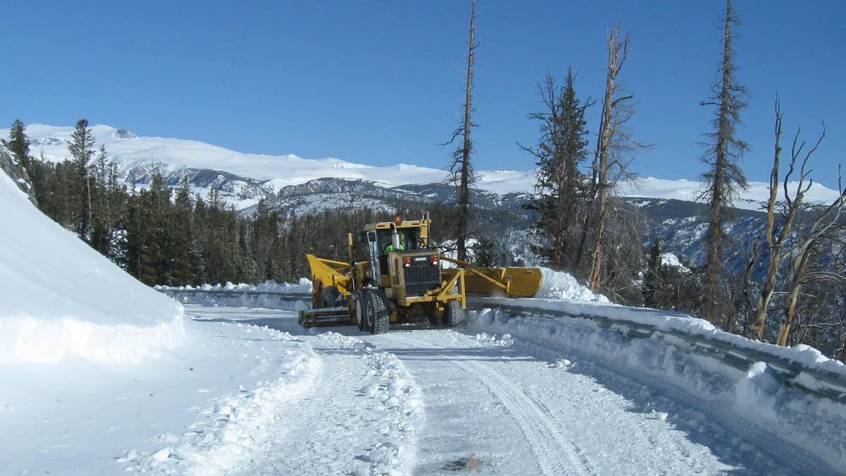 Plow clearing a snowy Montana highway.