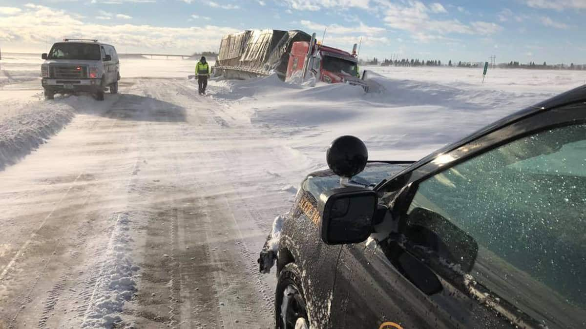 Tractor-trailer accident on a snowy North Dakota highway.