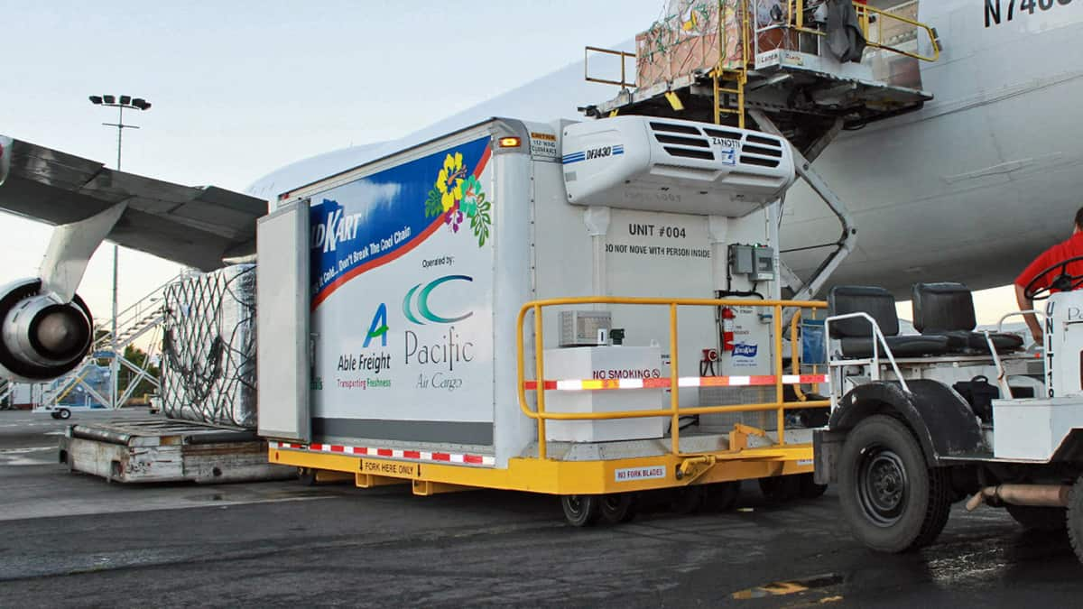 A refrigerated container ready to be loaded on a plane.