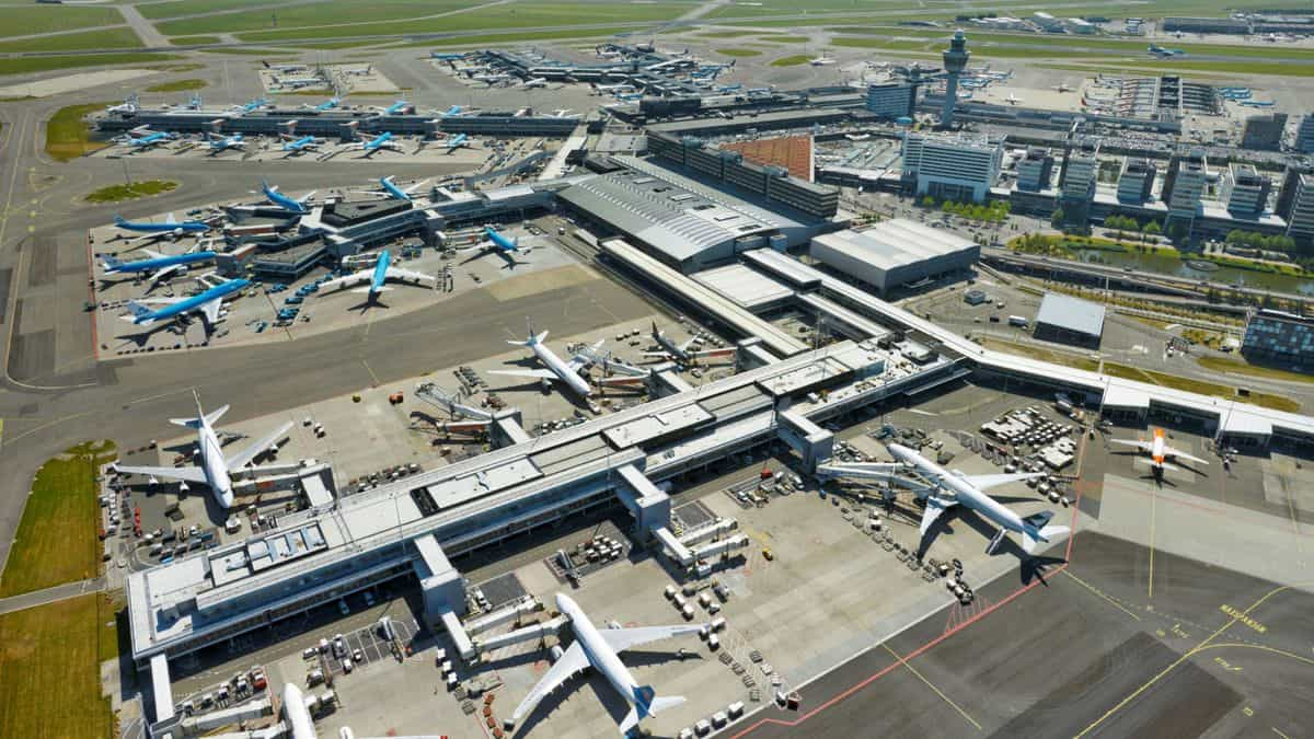 Aerial view of Amsterdam Airport terminals with planes.