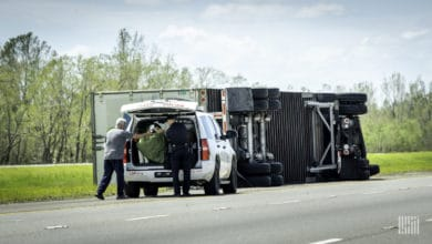 Overturned truck on side of highway