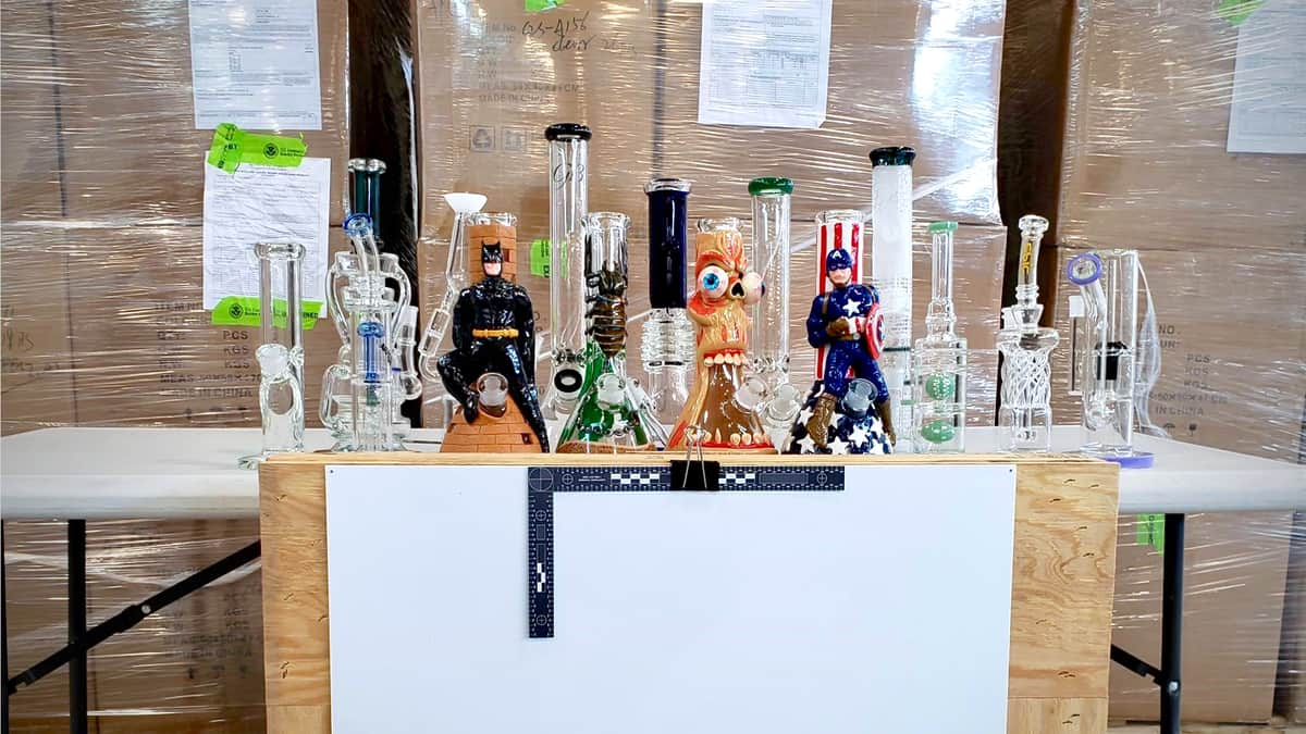 Glass bongs are lined up after being seized by from a truck at the US Canada border, amid a rise of marijuana seizures.