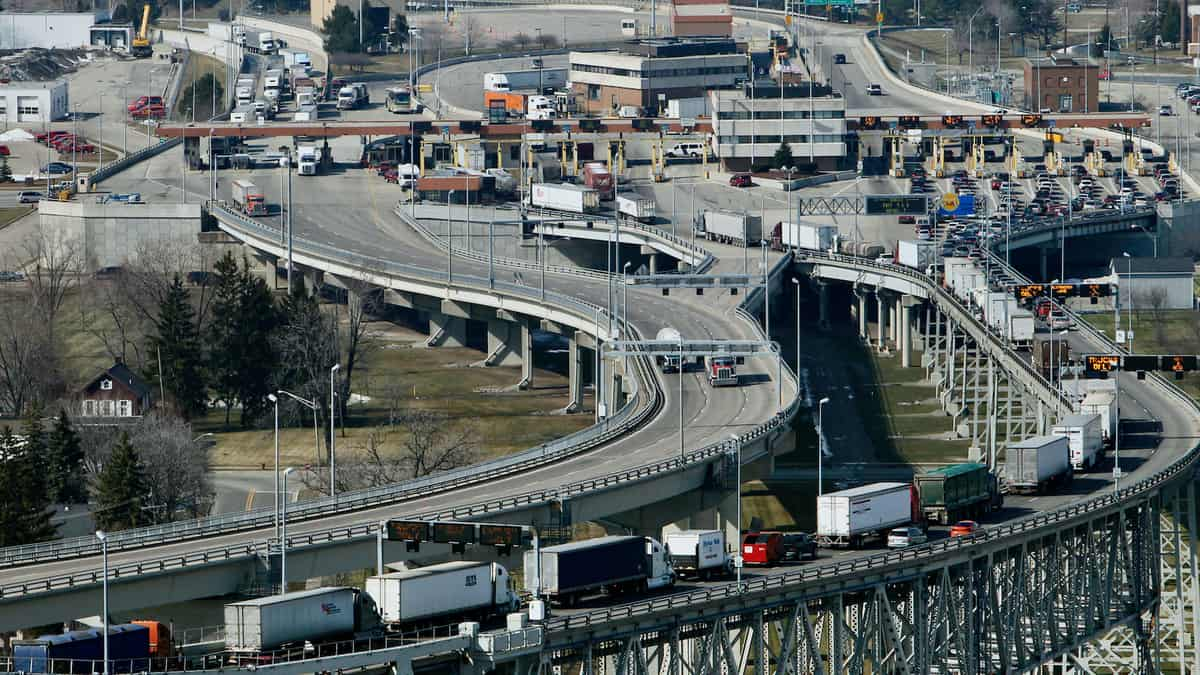 Trucks cross the the U.S.-Canada border. The US election could impact cross-border trade.