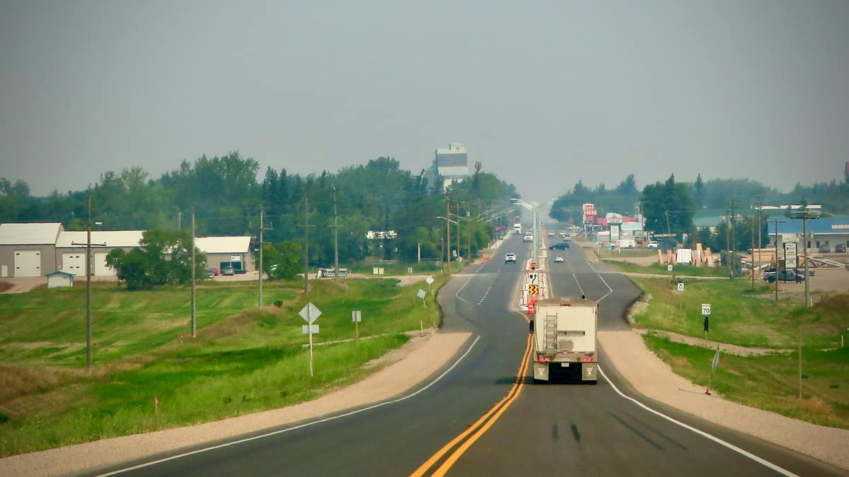 The view behind a truck moving on the road in Manitoba, Canada, where two trucking companies were recently placed into receivership