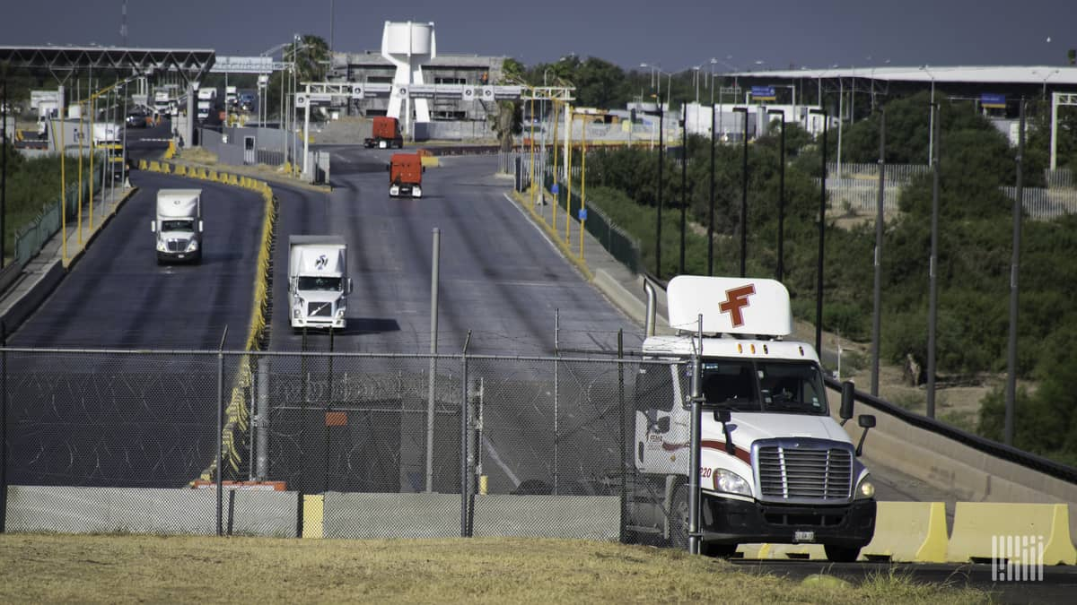 A view of trucks crossing the U.S.-Mexico border. Texas customs broker Daniel B. Hastings was recently targeted by ransomware hackers.