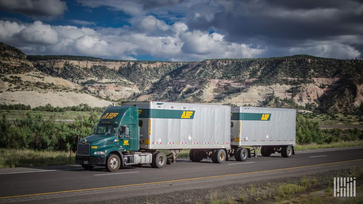 An ABF tractor pulls two ABF-branded twin trailers. (Photo: Jim Allen/FreightWaves)