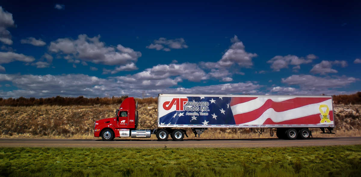 An Affiliated Foods tractor-trailer rolls down the road.