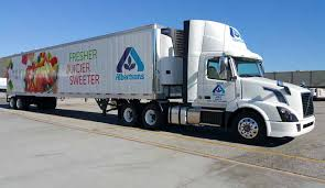 An Albertsons truck is a rolling billboard for the supermarket chain.
