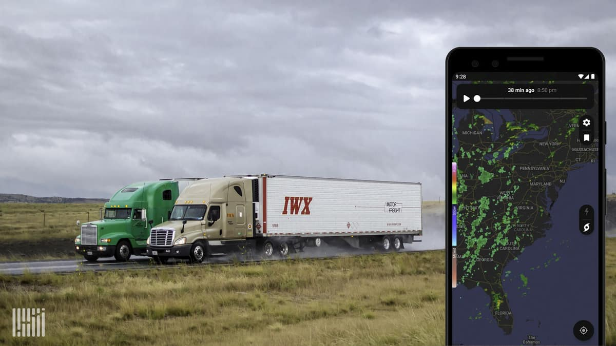 Tractor-trailers heading down a highway. Inlay photo of a mobile phone showing the NOAA radar app.