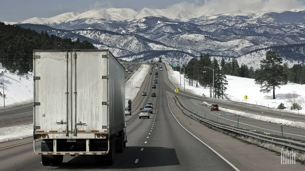 Tractor-trailer heading down a stretch of I-70 in Colorado.