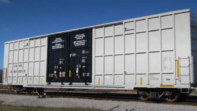 A photograph of a railcar in a yard.