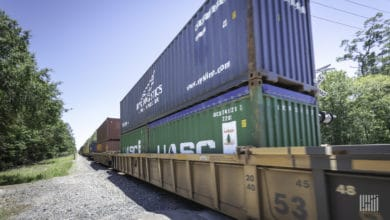 A photograph of a train hauling containers.