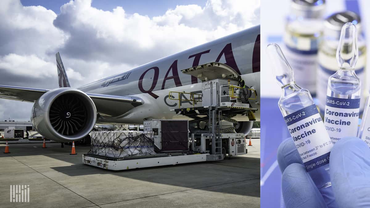 Light gray Qatar Airways cargo plane being loaded at airport from side door.