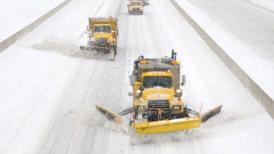 Plows clearing a snowy Pennsylvania highway.