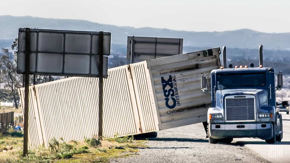 Tractor-trailer rolled over on side of Interstate 15 in California.