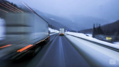 Trucks on snowy highway