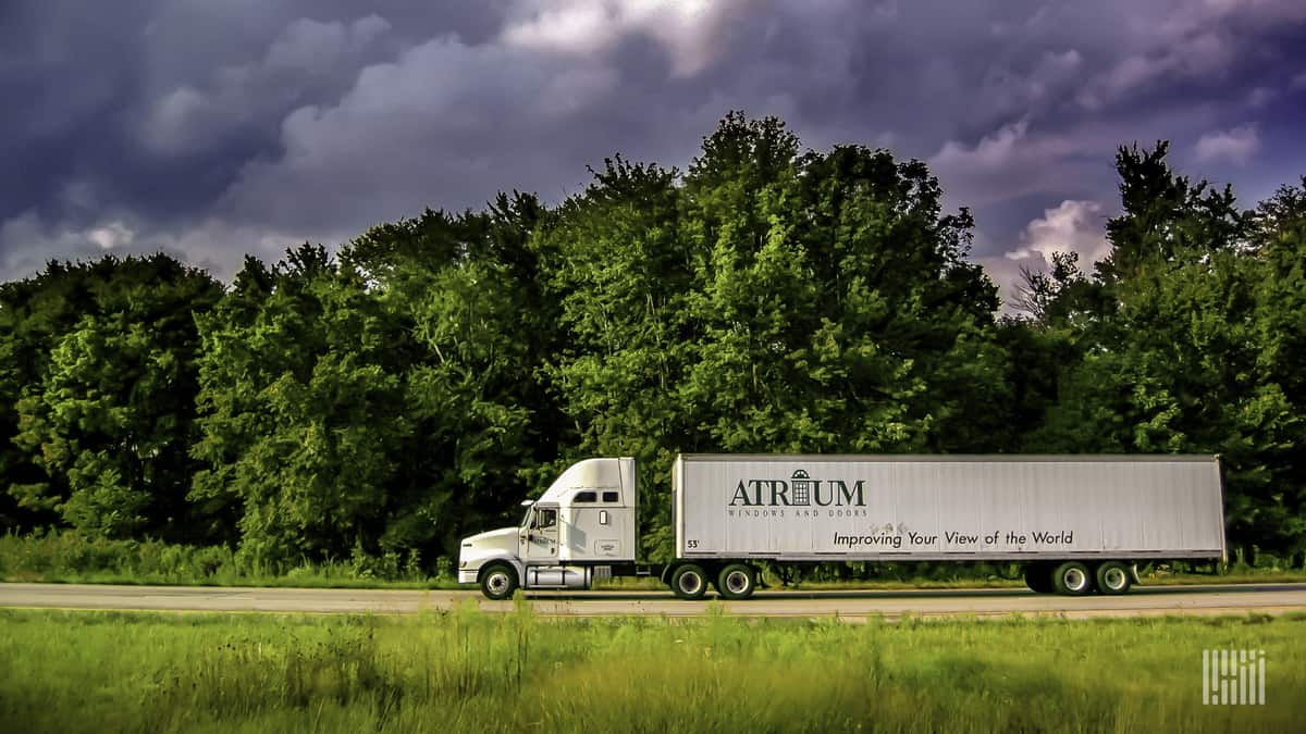 Carrying a load of premium windows and doors, this Atrium tractor-trailer moves down the highway.  (Photo: Jim Allen/FreightWaves)