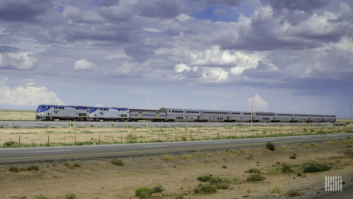 A photograph of an Amtrak train traveling across a grassy field.