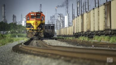 A photograph of a Kansas City Southern train in a rail yard.