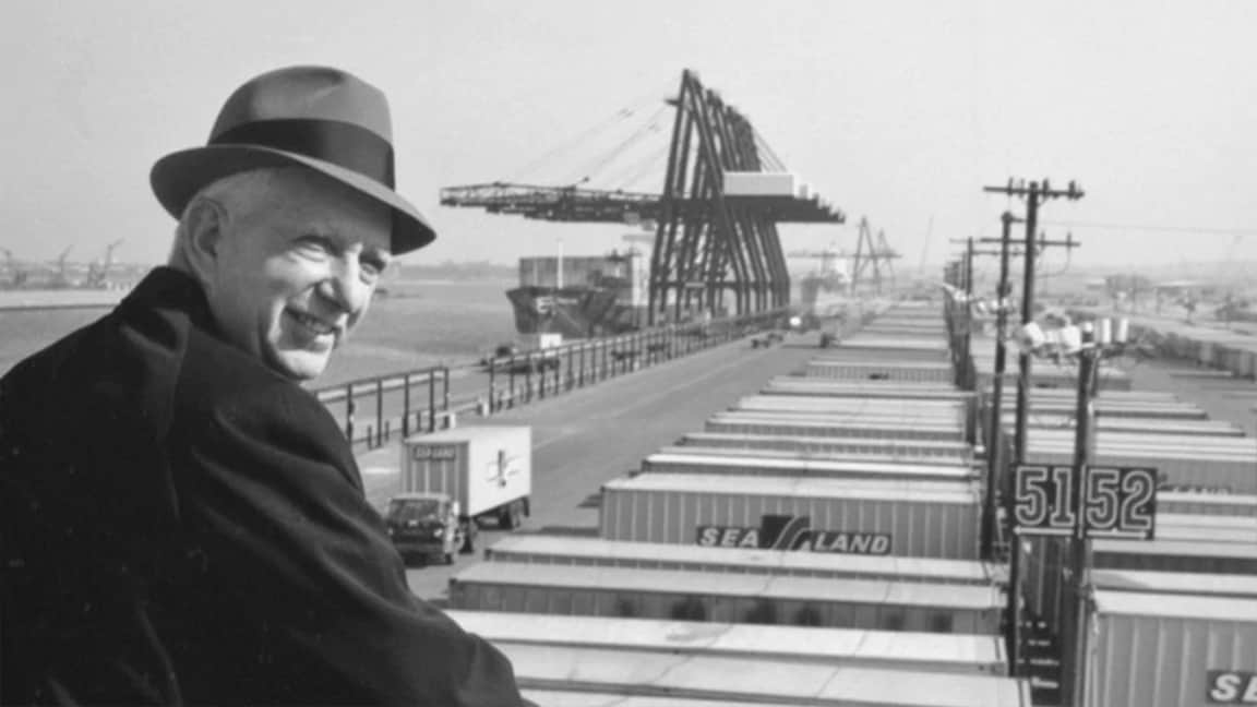 Malcom McLean shown dockside above Sea-Land containers.  A.P. Møller - Mærsk purchased Sea-Land in 1999.  (Photo: americanbusinesshistory.org)