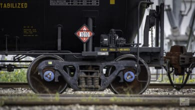 A photograph of a railcar's set of wheels.