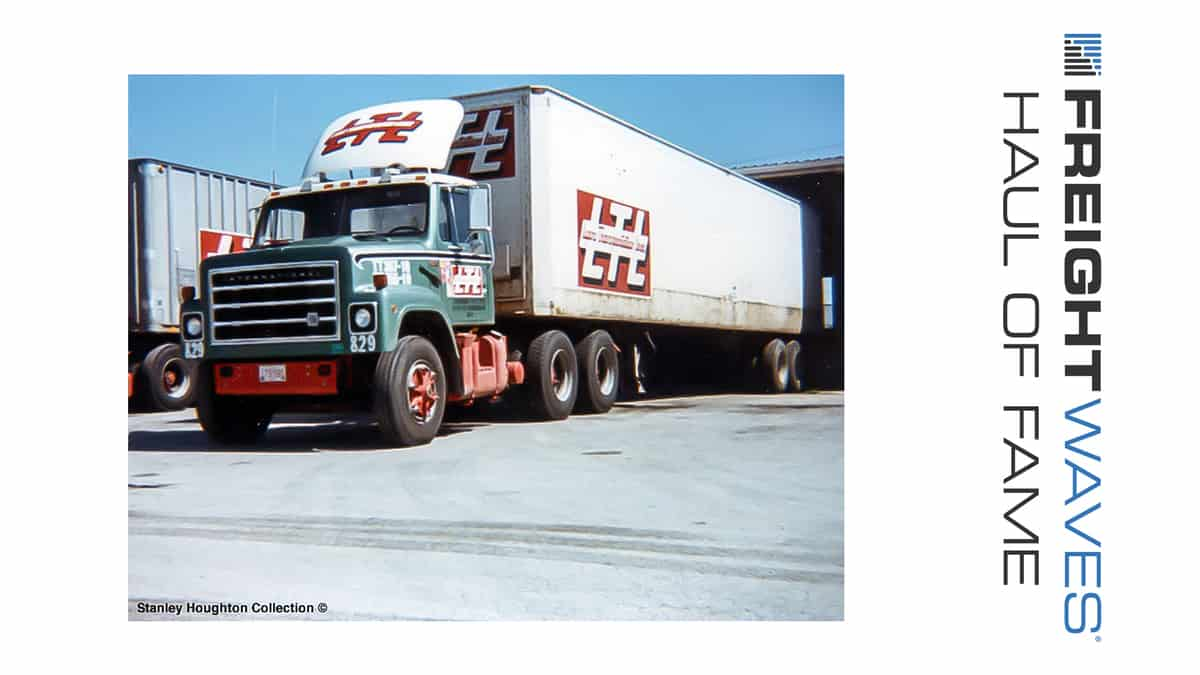 A Lyons Transportation Lines tractor-trailer waits at a dock to load. (Photo: Stanley Houghton Collection)