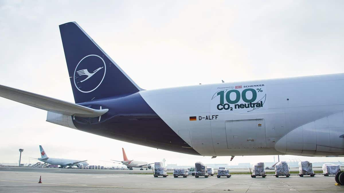Tail end of Lufthansa jet with logo showing 100% carbon neutral flight.