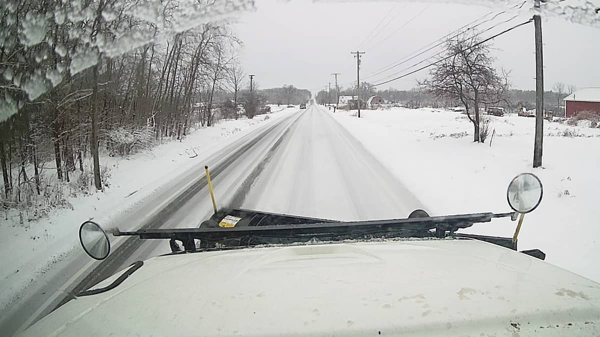 Snow plow clearing an Ohio highway.