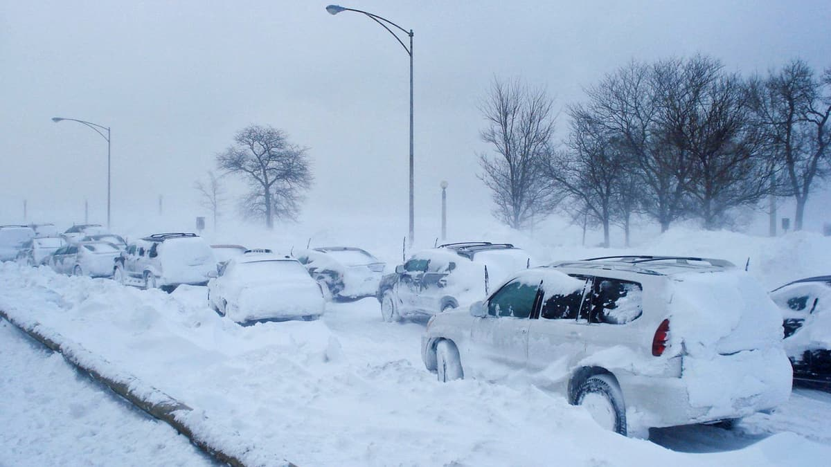 Cars parked in deep snow.