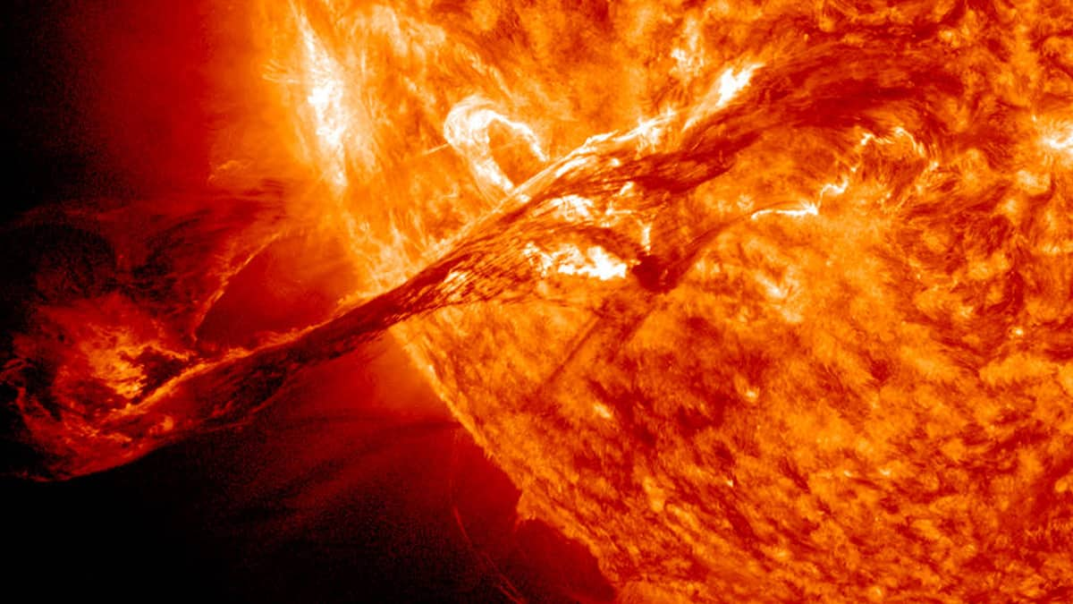 Photo of a solar flare shooting from the sun.
