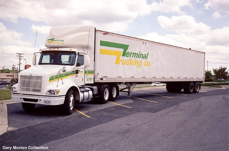 Terminal Trucking Co. trucks backed into a loading dock. (Photo: Stanley Houghton Collection)
