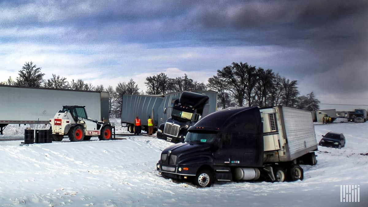 Damaged tractor-trailers skidded off a snowy highway.