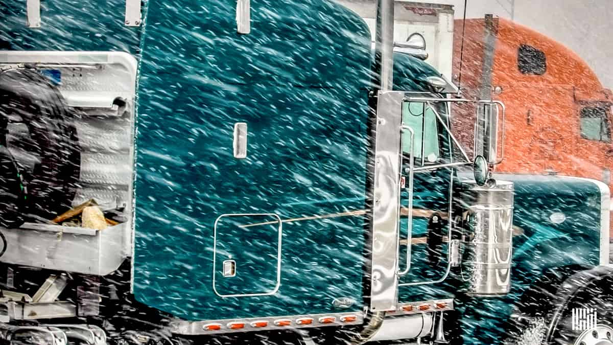 Tractor-trailer in blowing snow.