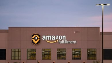 A brown Amazon warehouse with sign on front.