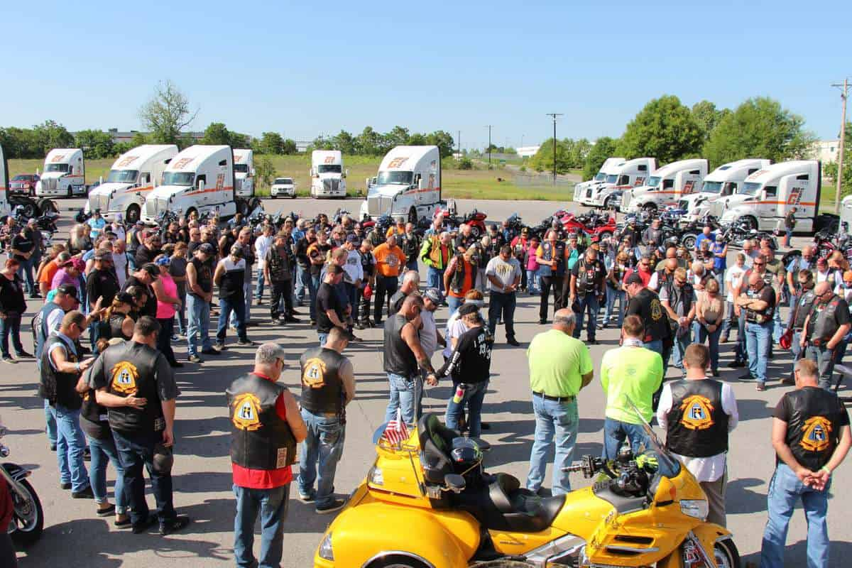 Big G Express employees, families and friends bow their heads in prayer as the motorcycle ride to support St. Jude Children's Hospital is about to begin. (Photo courtesy of Big G Express Facebook page)