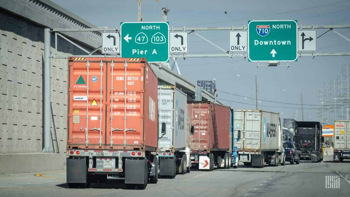 This photo shows trucks exiting a Southern California port complex. Note signs for I-710 (a spur of I-10) and California state routes as well. (Photo: Jim Allen/FreightWaves)