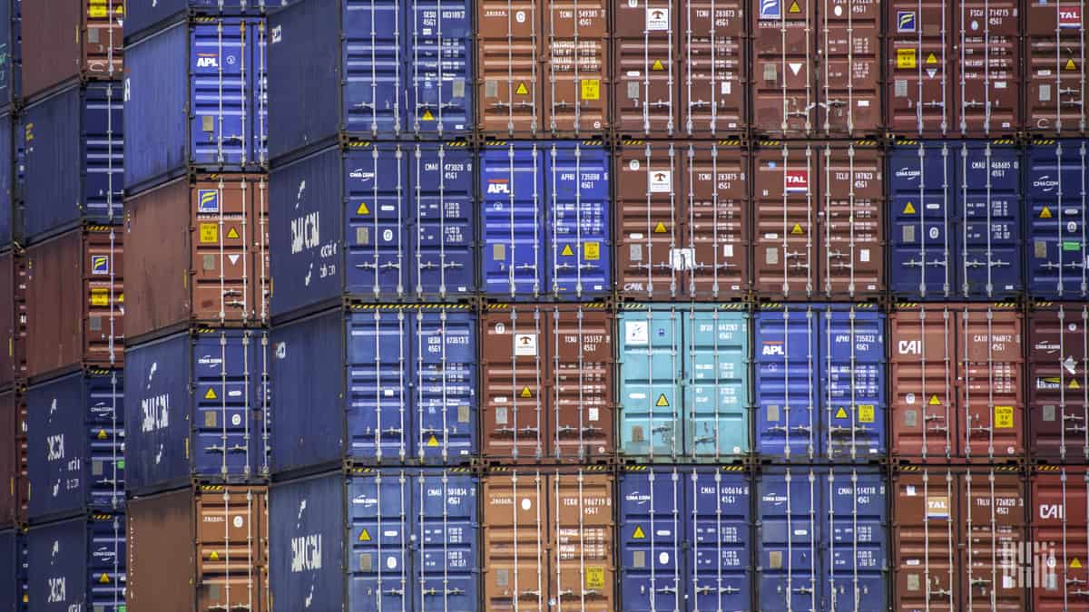 Shipping containers stacked at a port to illustrate Descartes Systems third quarter financial results