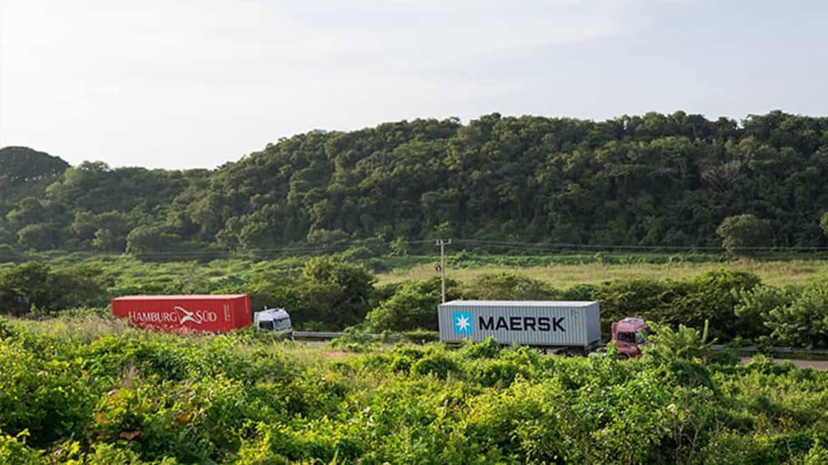 A truck carrying a Hamburg Süd-branded container follows another truck hauling a Maersk-branded container.  (Photo: A.P. Møller - Mærsk)