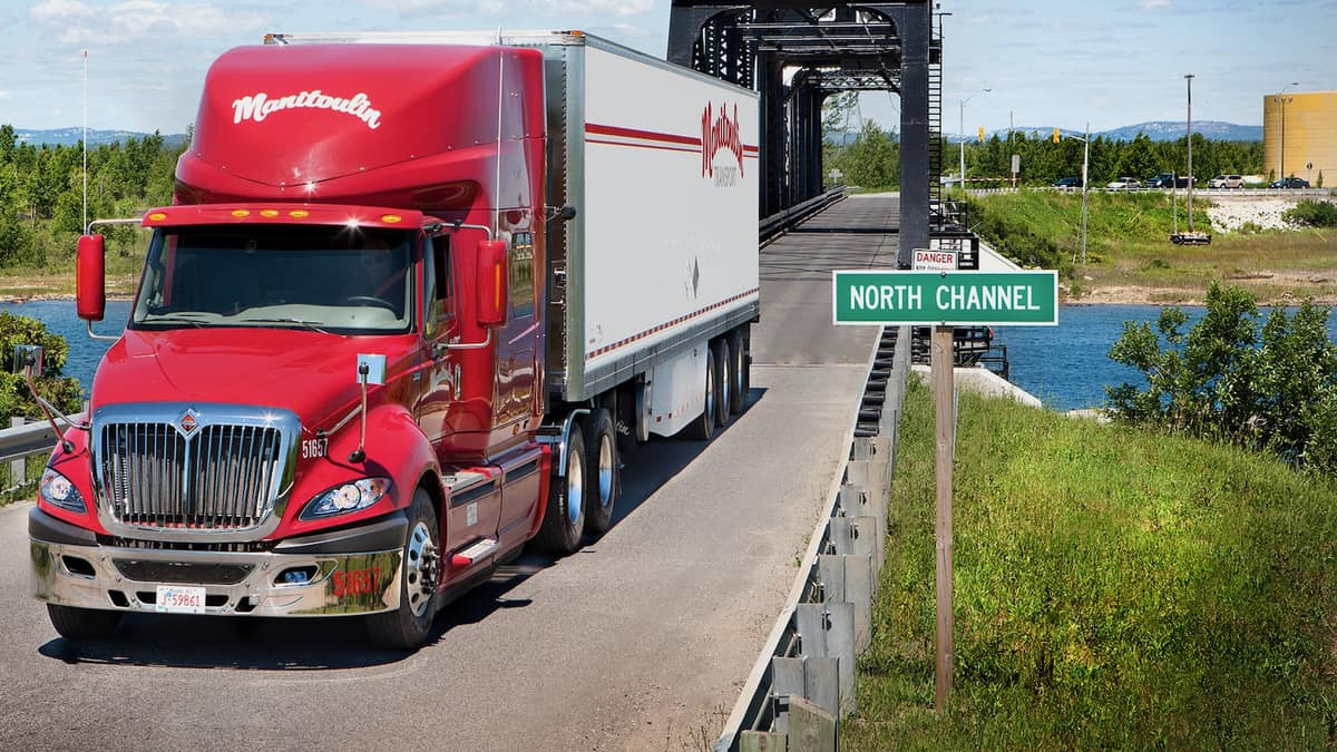 A tractor-trailer of Manitoulin Transport crossing a bridge. Manitoulin acquired a third US freight forwarder.