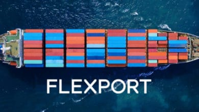 Container vessel image looking down from the air. Flexport logo on the water.