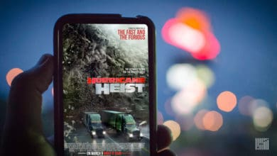 "Smart phone showing ad for the movie ""The Hurricane Heist""."