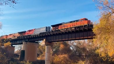 A photograph of a BNSF train crossing a bridge.
