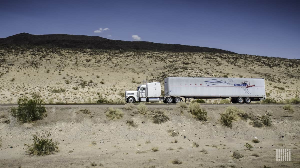 A Broadway Express tractor trailer carries household furniture - or is it the set of a Broadway musical?  (Photo: Jim Allen/FreightWaves)