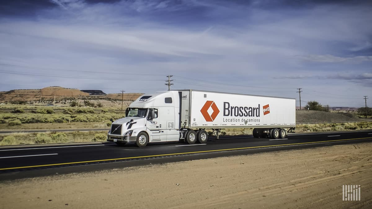 A Brossard Leasing trailer is pulled down the road. (Photo: Jim Allen/FreightWaves)