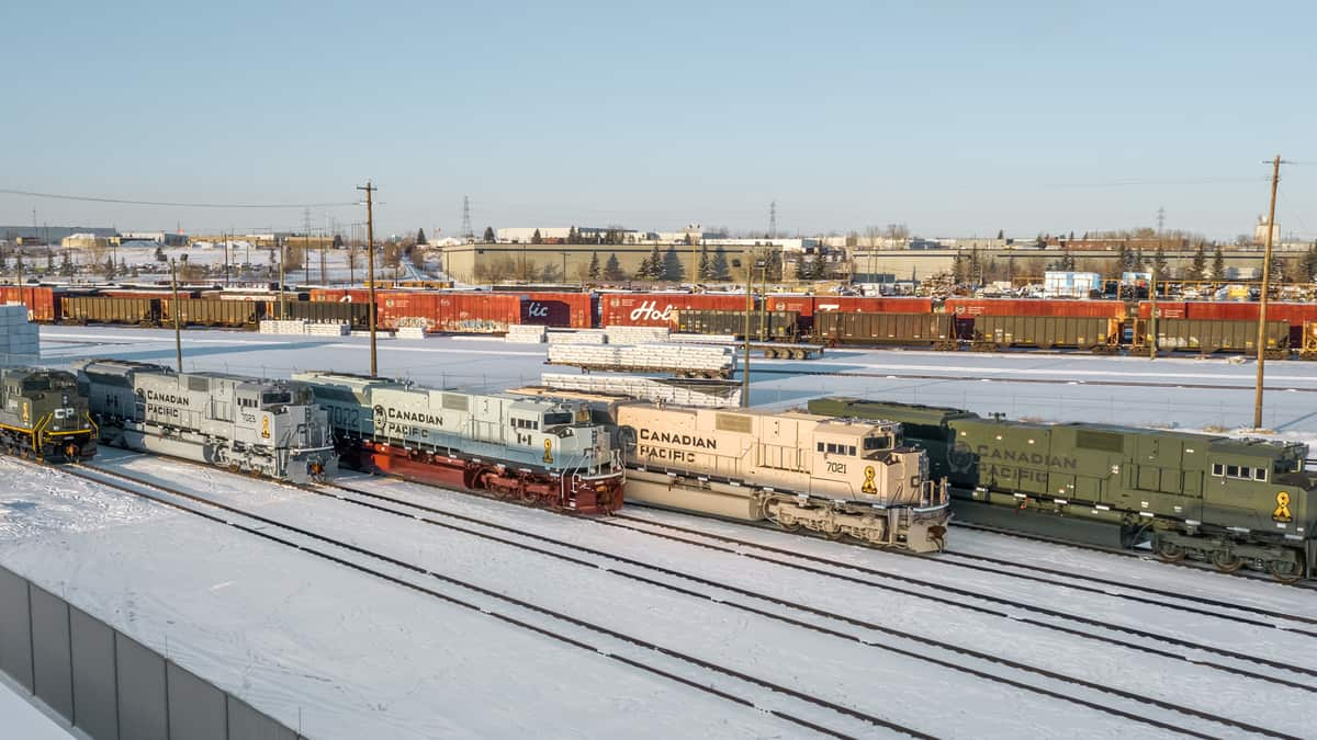 A photograph of a Canadian Pacific train at a rail yard.