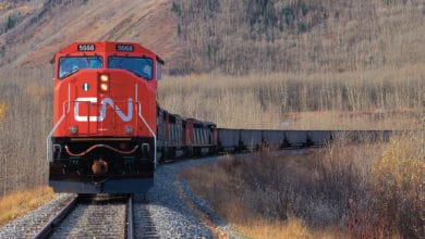 A photograph of a CN train traveling through a field.